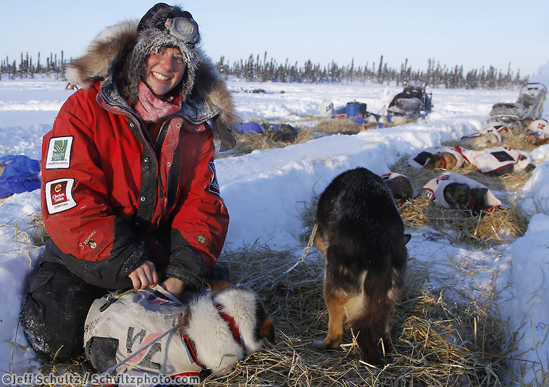 Friday March 9, 2012  Ryne Olson puts on dog salve at the half-way checkpoint at Cripple.   Iditarod 2012.