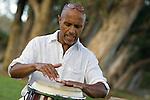Man playing conga drums