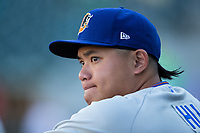 Durham Bulls pitcher Chih-Wei Hu (19) in the dugout prior to the game against the Charlotte Knights at BB&T BallPark on May 15, 2017 in Charlotte, North Carolina. The Knights defeated the Bulls 6-4.  (Brian Westerholt/Four Seam Images)