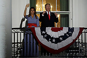 United States President Donald J. Trump and First Lady Melania Trump react from the Truman Balcony of the White House during a fireworks display in Washington, D.C., U.S., on Wednesday, July 4, 2018. Trump's campaign won the technical knockout of a lawsuit filed by two Democratic National Committee donors and a DNC staffer who accused it of colluding with Russian to publish compromising information about the Clinton campaign on WikiLeaks that included details about their lives. <br /> Credit: Yuri Gripas / Pool via CNP