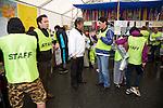 """Minamisanriku, Miyagi, Japan - Volunteers wear staff uniforms at Minamisanriku Volunteer Center, one year after the tsunami. The Latin group of volunteers """"Todos con Japon"""" visits Miyagi area during this Golden Week."""