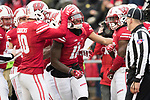 Wisconsin Badgers teammates celebrate a punt return for a touchdown by Nick Nelson (11) during an NCAA College Big Ten Conference football game against the Michigan Wolverines Saturday, November 18, 2017, in Madison, Wis. The Badgers won 24-10. (Photo by David Stluka)