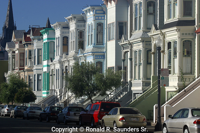 Row of Victorian homes unique for its colorful (colourful) pastel exteriors, and typically seen in<br />  San Francisco, California, USA