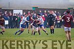 St Marys Bryan Sheehan & Daniel Daly mark Piarsaigh na Dromoda's Pádraig Ó Suilleabháin into loosing possession.