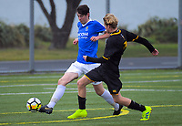 Action from the Wellington premier boys youth football match between St Patrick's College (Town) and Wellington College at Evan's Bay Park in Wellington, New Zealand on Tuesday, 28 May 2019. Photo: Dave Lintott / lintottphoto.co.nz