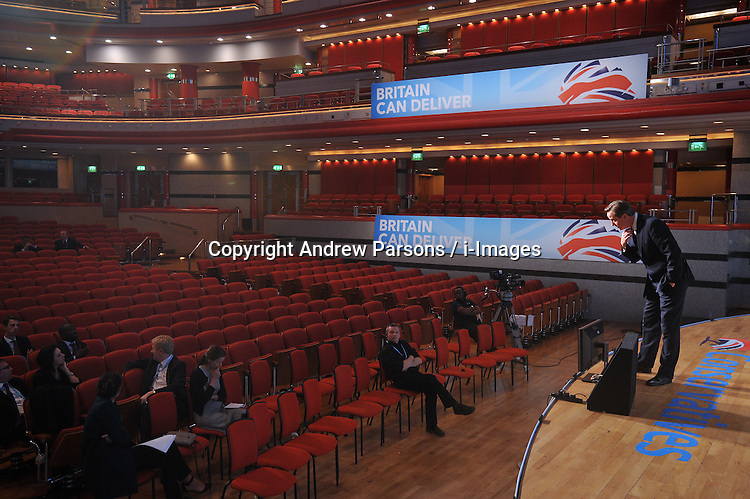 David Cameron rehearses his final speech in the main conference auditorium during the Conservative party conference, International Convention Centre, October 9, 2012, Birmingham, England. Photo by Andrew Parsons / i-Images..