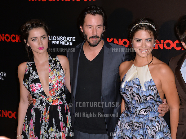 Keanu Reeves with Ana de Armas (left) &amp; Lorenza Izzo at the Los Angeles premiere of their movie &quot;Knock Knock&quot; at the TCL Chinese Theatre, Hollywood.<br /> October 7, 2015  Los Angeles, CA<br /> Picture: Paul Smith / Featureflash
