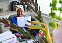 MIRAMAR, FL - MARCH 31: Broward County Kindergarten teacher Lisa holding a sign for her student in front of her laptops during distance virtual school learning amid Coronavirus Pandemic in Broward County, Florida Public Schools. Florida began their experience with online virtual distance learning, amid the growing coronavirus (COVID-19) pandemic on March 31, 2020 in Miramar, Florida.   ( Photo by Johnny Louis / jlnphotography.com )