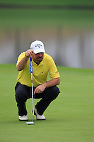Thomas Bjorn (DEN) on the 11th green during Friday's Round 2 of the 2014 BMW Masters held at Lake Malaren, Shanghai, China 31st October 2014.<br /> Picture: Eoin Clarke www.golffile.ie