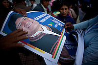 La Paz, Bolivia<br /> A picture dated November 26, 2009 show a woman supporter of Bolivian President and presidential candidate Evo Morales distributes posters of Morales to supporters in a campaign event in the City of La Paz.  Morales are running for re-election for the MAS (Movement Towards Socialism) party, and has more than 50% support of the population.