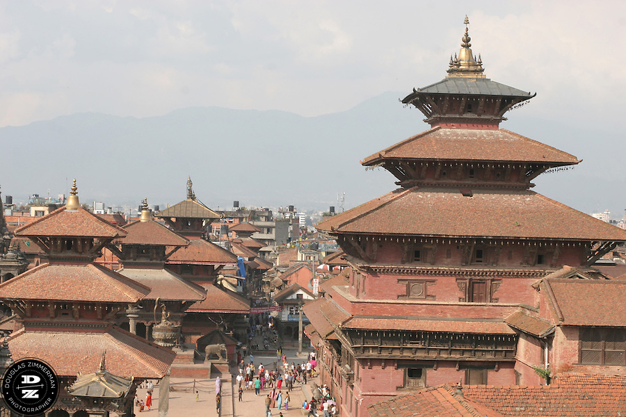 The Nepalese-style roofs of the temples and monuments of Patan's Durbar Square dominate the skyline in Patan, Nepal.  Photograph by Douglas ZImmerman