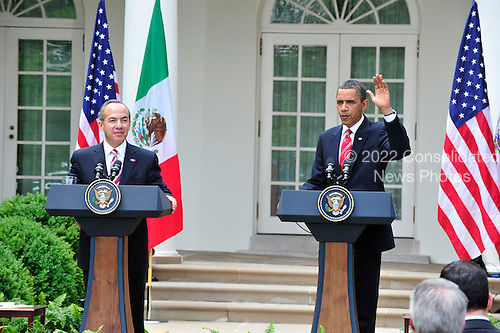 United States President Barack Obama, right, and President Felipe Calderón of Mexico, left, conclude a joint press conference in the Rose Garden of the White House in Washington, D.C. during a State Visit on Wednesday, May 19, 2010..Credit: Ron Sachs / CNP