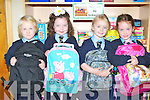 Saoirse Moriarty, Isabelle Sweetman, Molly Reidy and Rachel Fuller get their bags ready to go home at their first day of school in Loughquittane NS on Monday..