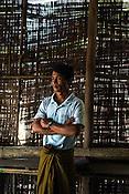 43 year old Thang Kywe, the chairman of Village Fisheries Society poses for a portrait in Kant Ma Lar Chang Village in Pyapon district of Myanmar.