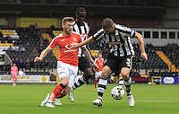 Jordan Cook runs into trouble during the Sky Bet League 2 match between Notts County and Luton Town at Meadow Lane, Nottingham, England on 29 October 2016. Photo by Liam Smith / PRiME Media
