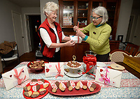 NWA Democrat-Gazette/ANDY SHUPE<br /> Jane Bryant (left) and Jeffi O'Kane, both longtime volunteers with the Friends of the West Fork Library, set up Thursday, Feb. 7, 2019, for the third annual Valentine Chocolate Buffet in Library Hall north of the library in West Fork. The sale is planned for 10 a.m. to noon Saturday and will feature locally made chocolate items in a special Valentine's Day box for a $10 or $12 donation to the group to help fund its mission to support the library and its expansion.