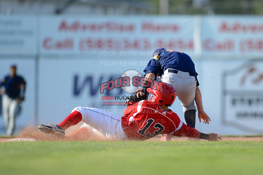 State College Spikes infielder Bruce Caldwell #13 tags out Avery Romero #13 sliding in during a game against the Batavia Muckdogs on June 29, 2013 at Dwyer Stadium in Batavia, New York.  Batavia defeated State College 3-1.  (Mike Janes/Four Seam Images)