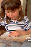 Preschooler age 5 reading picture book.  Western Springs  Illinois USA