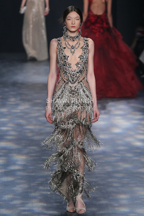 Model Yumi walks runway in a gunmetal and black diamond jeweled necklace column gown with plunging v-neck and ombré bugle bead tiered fringe skirt, from the Marchesa Fall 2016 collection by Georgina Chapman and Keren Craig, presented at NYFW: The Shows Fall 2016, during New York Fashion Week Fall 2016.