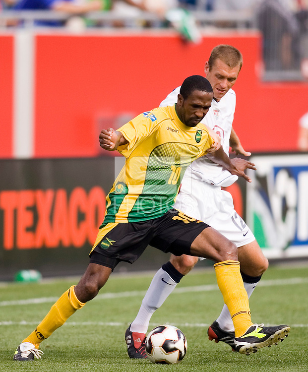 Jamaica's Ricardo Fuller holds off USA's Jimmy Conrad. The United States defeated Jamaica 3 to 1 in quarterfinal CONCACAF Gold Cup action at Gillette Stadium, Foxbourgh, MA, on July 16, 2005.