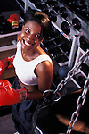 Portrait of a young Black boxer during her workout