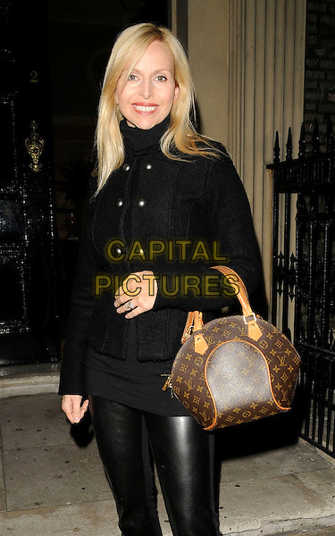 ANNEKA SVENSKA .Arrives at the Berkeley Square Ball VIP launch, Home House, Portman Square, London, England, UK, .September 14th 2009..half length Louis Vuitton logo bag handbag black military style jacket buttons  shiny  leather trousers smiling .CAP/CAN.©Can Nguyen/Capital Pictures