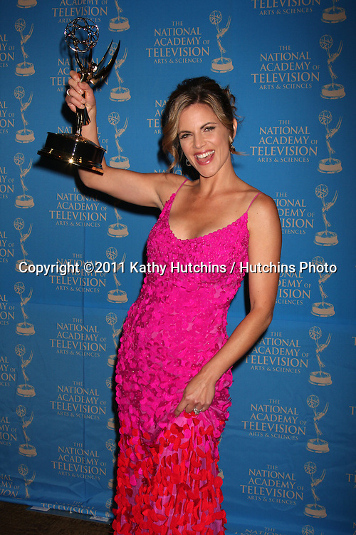 LOS ANGELES - JUN 17:  Natalie Morales accepting Emmy for Director  Joe Michaels in the Press Area at the 38th Annual Daytime Creative Arts & Entertainment Emmy Awards at Westin Bonaventure Hotel on June 17, 2011 in Los Angeles, CA