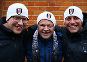 17th March 2018, Craven Cottage, London, England; EFL Championship football, Fulham versus Queens Park Rangers; Group of Fulham fans wearing winter hats pose outside Craven Cottage before kick off