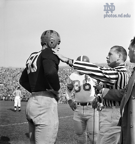 GMCJ 1/31:  Football Game Day - Notre Dame vs. Michigan State (MSU), 1950/1028.  A referee talking with Notre Dame Captain Jerry Groom (#50) and the MSU captain before the start of the game for the coin toss.  Image from the University of Notre Dame Archives.