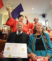 George Gray (left), 91, and his wife Joan Gray of Burlington City, New Jersey sit in the front row as members of the church choir sing after the Congressional Gold Medal he was presenting to Mr. Gray for his roll as a Montford Point Marine Sunday January 10, 2016 at Bethel AME Church in Bristol, Pennsylvania. (Photo by William Thomas Cain)