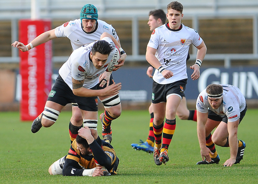 Carmarthen Quins' Lee Taylor is tackled by Newports' Adam Brown <br /> <br /> Photographer Craig Thomas/CameraSport<br /> <br /> Rugby Union - Rugby Union - Welsh Premier Division - Principality Premiership - Newport RFC v Carmarthen Quins - Saturday 17th January 2015 - Rodney Parade - Newport<br /> <br /> &copy; CameraSport - 43 Linden Ave. Countesthorpe. Leicester. England. LE8 5PG - Tel: +44 (0) 116 277 4147 - admin@camerasport.com - www.camerasport.com