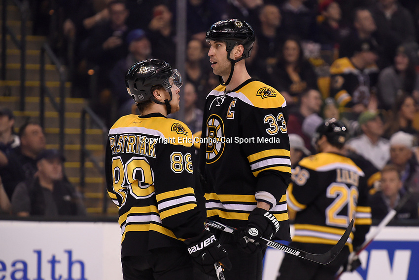 Thursday, March 10, 2016: Boston Bruins defenseman Zdeno Chara (33) talks to left wing David Pastrnak (88) during a break in the action at the National Hockey League game between the Carolina Hurricanes and the Boston Bruins held at TD Garden, in Boston, Massachusetts. Carolina beats Boston 3-2 in overtime. Eric Canha/CSM