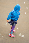 Toddler blowing bubbles.