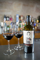 Glasses and bottle of red wine of El Canto de la Alondra, ribera del Duero wine in a bar by River Duero, Navarro, Spain