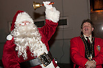 Santa rings his bell as Mayor Michael O'Dowd counts down at the switching on of the Christmas lights on West Street, last Friday.