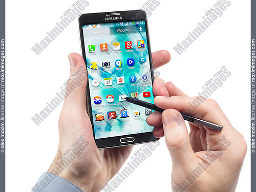 Man hands with Samsung Galaxy Note III smartphone isolated on white background