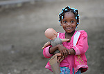 A girl with a white doll in Batey Bombita, a community in the southwest of the Dominican Republic whose population is composed of Haitian immigrants and their descendents.