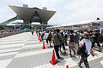 Thousands of visitors line up to enter to Comic Market 90 (Comiket) event at Tokyo Big Sight on August 12, 2016, Tokyo, Japan. Many manga and anime fans wearing cosplay lined up in the sun for the first day of Comiket. Comiket was established in 1975 and focuses on manga, anime, gaming and cosplay. Organizers expect more than 500,000 visitors to attend this year's summer event which runs for three days until August 14. (Photo by Rodrigo Reyes Marin/AFLO)