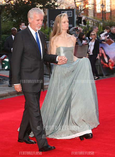 James Cameron and wife arriving for the Titanic 3D film premiere, Royal Albert Hall, London. 27/03/2012 Picture by: Alexandra Glen / Featureflash