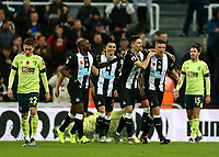 9th November 2019; St James Park, Newcastle, Tyne and Wear, England; English Premier League Football, Newcastle United versus AFC Bournemouth; Ciaran Clark of Newcastle United is hugged by Federico Fernandez  with Jetro Willems and  Miguel Almiron of Newcastle United close by after he scores in the 52nd minute to make it 2-1 - Strictly Editorial Use Only. No use with unauthorized audio, video, data, fixture lists, club/league logos or 'live' services. Online in-match use limited to 120 images, no video emulation. No use in betting, games or single club/league/player publications