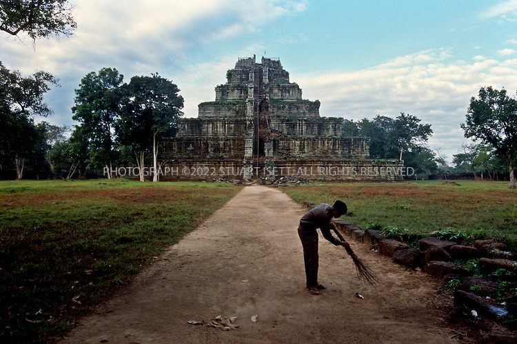12/1/2008--Angkor, Cambodia..Koh Ker is an Angkorian site in northern Cambodia. 100 km northeast of Angkor itself, it was briefly the capital of the Khmer empire between 928 and 944 under king Jayavarman IV and his son Hasavarman II.After the Khmer empire had been established in the Angkor area (Roluos), Jayavarman IV moved the capital in 928 almost 100km northeast to Koh Ker. Here a vast number of temples were built under his reign, until his successor returned to the Angkor area about twenty years later...The Koh Ker site is dominated by Prasat Thom, a 30 meter tall temple mountain raising high above the plain and the surrounding forest. Great views await the visitor at the end of an adventurous climb. Garuda, carved into the stone blocks, still guard the very top, although they are partially covered now...Across the site of Koh Ker there are many prasat or tower sanctuaries. A couple still feature an enormous linga on a yoni that provides space for several people. The outlet for the water that was sanctified by running it over the linga can be seen in the outside wall of one of them. In other cases, three prasat stand next to each other, dedicated to Brahma, Shiva and Vishnu. Most of them are surrounded by libraries and enclosures, many also had moats. At that time, the roofs were still made of wood. Today, only the holes for the beams remain in the stone structures...The site is still 3 hours away from Siem Reap, the area has been demined only recently and basic visitors' facilities are just being built. This makes Koh Ker very attractive for anyone who would like to experience lonely temples partially overgrown by the forest and inhabited only by birds, calling to each other from the trees above...©2008 Stuart Isett. All rights reserved.