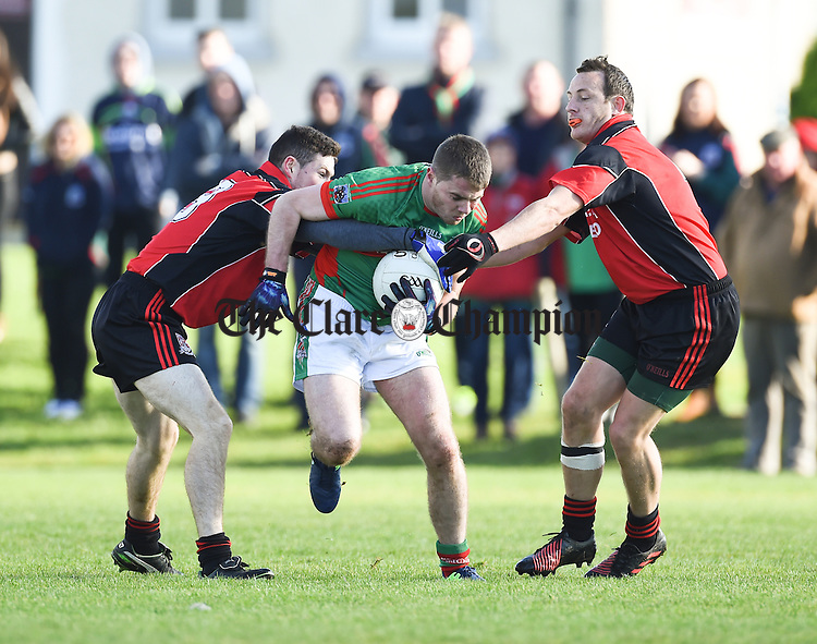 Colm Donnellan of Kilmurry Ibrickane  in action against Shane O Brien and Stephen Hayes of Meelick during their Junior A  county final at Gurteen. Photograph by John Kelly.