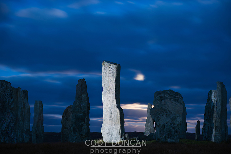 Callanish standing stones illuminated by light at night, Isle of Lewis, Outer Hebrides, Scotland
