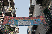 the banner of Mimmo Cuticchio theatre and workshop in Via Bara all'Olivella,.Via bara all'olivella, sede del teatro di Mimmo Cuticchio