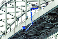 Workers repair and inspect the Blue Water Bridge