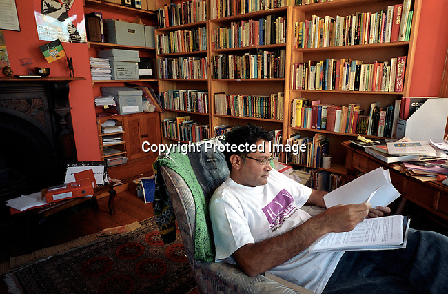 Zachie Achmat, the head of TAC, Treatment Action Campaign, a HIV-Aids activist organization, reading documents in his study in his house in Muizenberg outside Cape Town, South Africa. TAC is fighting for the delivering of antiretroviral drugs to all South African, specially pushing the government to take action..Photo: Per-Anders Pettersson/ iAfrika Photos.