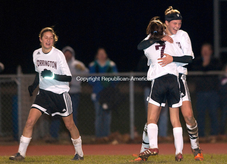 TORRINGTON, CT, 11 NOVEMBER 2010-111110JS04-Torrington's Sarah Royals (14) gets a hug from teammate Taylor Pestritto (7) after scoring a goal in their 4-2 loss to Masukin their Class L state tournament game Thursday at Torrington High School. <br />  Jim Shannon Republican-American