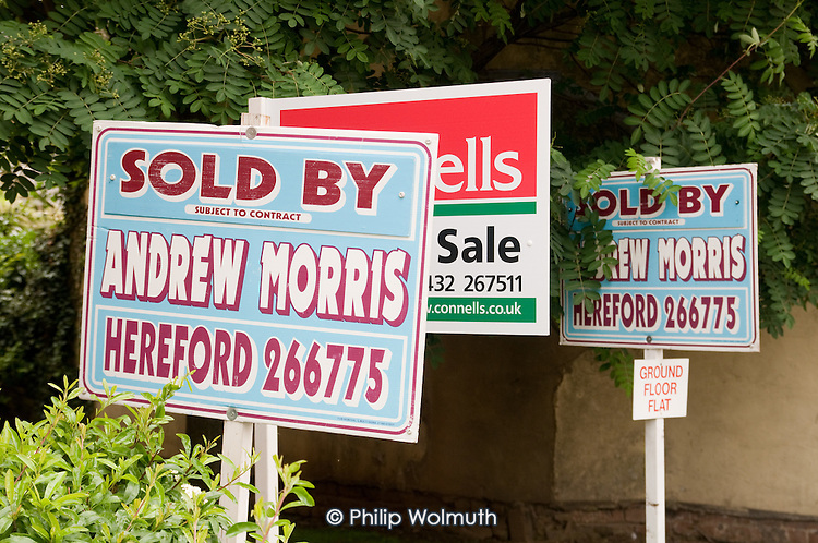 Estate agents' boards in Hereford