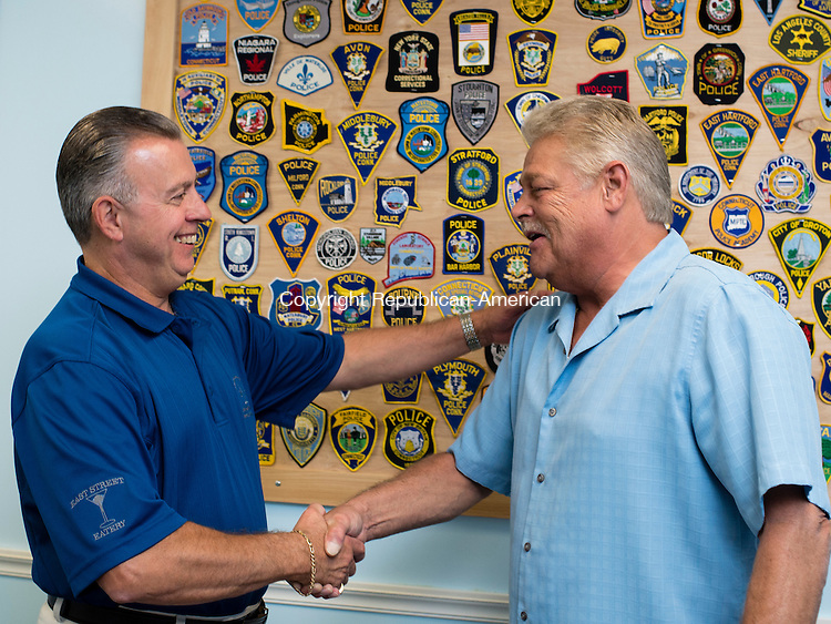WOLCOTT, CT - 25 September 2015-092515EC02-- Sgt. Brian Boutote gets congratulated by Chief Edward Stephens (L) for serving 30 years with the Wolcott Police Department. Erin Covey Republican-American.