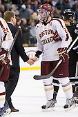 Nate Leaman (PC - Head Coach), Paul Carey (BC - 22) - The Boston College Eagles defeated the Providence College Friars 4-2 in their Hockey East semi-final on Friday, March 16, 2012, at TD Garden in Boston, Massachusetts.